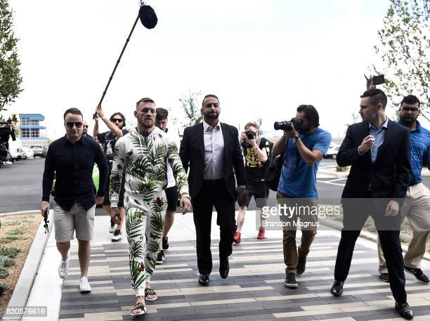 UFC lightweight champion Conor McGregor walks into the UFC Performance Institute during a media workout at the UFC Performance Institute on August 11...