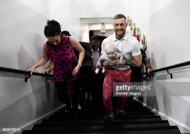 UFC lightweight champion Conor McGregor walks with his girlfriend Dee Devlin and son Conor McGregor Junior during a media workout at the UFC...