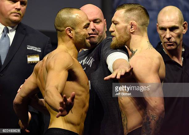 UFC lightweight champion Eddie Alvarez and Conor McGregor of Ireland face off during the UFC 205 weighin inside Madison Square Garden on November 11...
