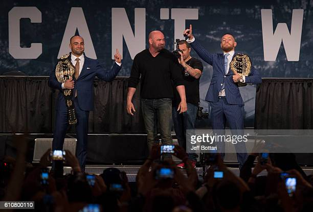 UFC lightweight champion Eddie Alvarez and UFC featherweight champion Conor McGregor interact with the media and fans during the UFC 205 press event...