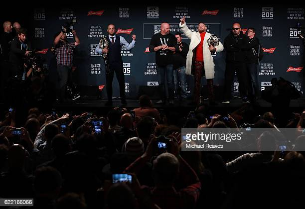 UFC lightweight champion Eddie Alvarez and UFC featherweight champion Conor McGregor of Ireland square up for a photo during the UFC 205 press...