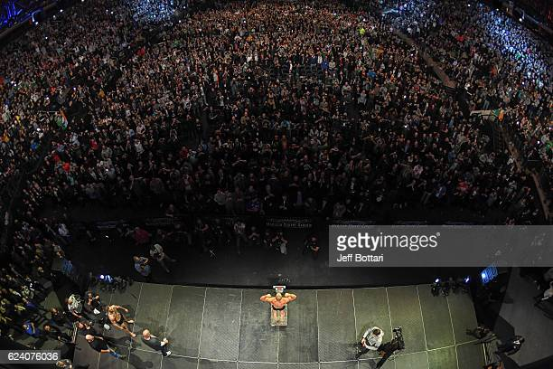 UFC lightweight champion Eddie Alvarez steps on the scale during the UFC 205 weighin inside Madison Square Garden on November 11 2016 in New York City