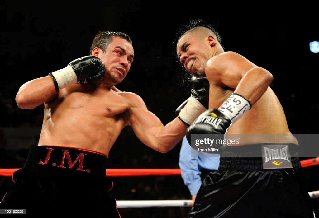 WBO lightweight champion <a gi-track='captionPersonalityLinkClicked' href=/galleries/search?phrase=Juan+Manuel+Marquez&family=editorial&specificpeople=4202669 ng-click='$event.stopPropagation()'>Juan Manuel Marquez</a> (L) hits Juan Diaz in the fourth round of their bout at the Mandalay Bay Events Center July 31, 2010 in Las Vegas, Nevada. Marquez retained his WBA and WBO lightweight championship belts with a unanimous-decision victory over Diaz.