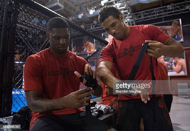 UFC lightweight Kevin Lee helps with hand wraps during a workout with the UFC stars on August 31 2015 in Las Vegas Nevada