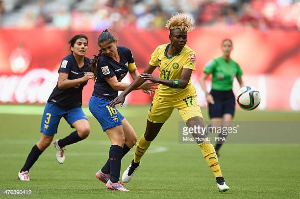 Ligia Moreira of Ecuador fouls Gaelle Enganamouit of Cameroon and receives a red card during the FIFA Women's World Cup 2015 Group C match between...