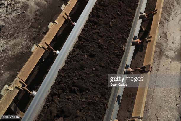 Lignite coal travels along a chute towards rail cars at the Welzow Sued openpit lignite coal mine on September 5 2017 near Welzow Germany Germany is...