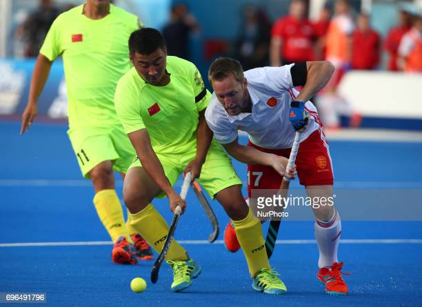E Liguang of China holds of Barry Middleton of England during The Men's Hockey World League 2017 Group A match between England and Chinaat The Lee...