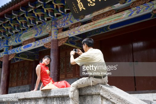 Lijiang. Chinese couple taking pictures.  : Stock Photo