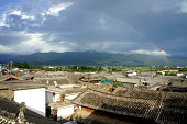 Lijiang old town rooftops with rainbow