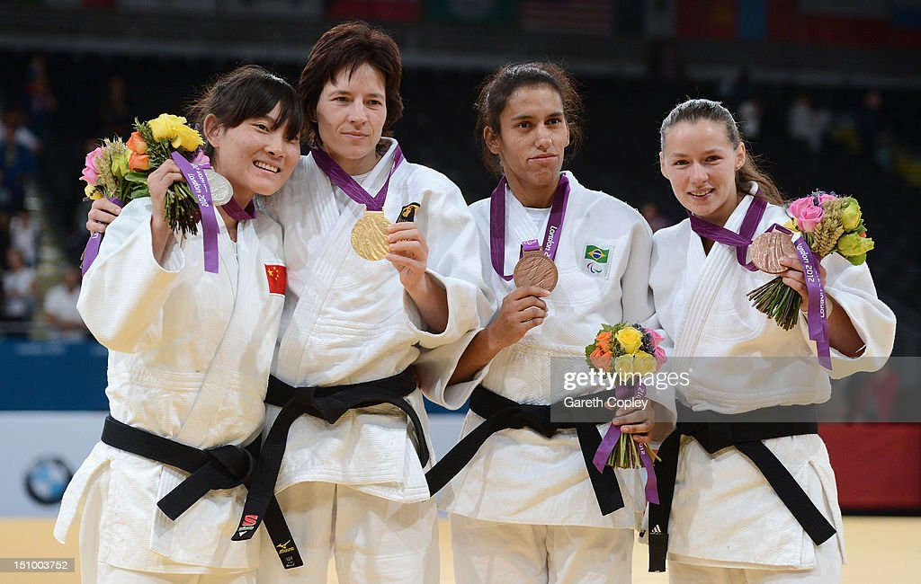 Lijing Wang of China, Ramona Brussig of Germany, Michele Ferreira of Brazil and Nataliya Nikolaychyk of Ukraine pose with their medals for the Women's -52 kg Judo on day 1 of the London 2012 Paralympic Games at ExCel on August 30, 2012 in London, England.