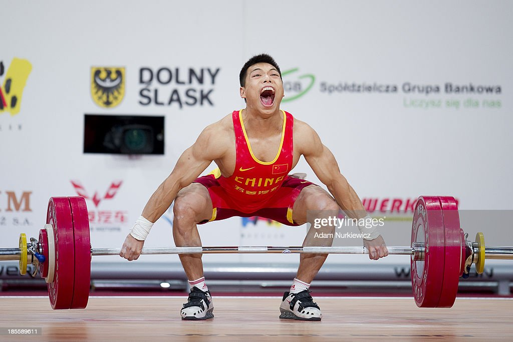 Lijun Chen from China lifts in Snatch competition men's 62 kg Group A during the IWF World Weightlifting Championships at Centennial Hall on October 22, 2013 in Wroclaw, Poland.
