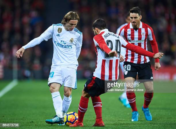 Lika Modric of Real Madrid CF being followed by Mikel Balenziaga of Athletic Club during the La Liga match between Athletic Club and Real Madrid at...