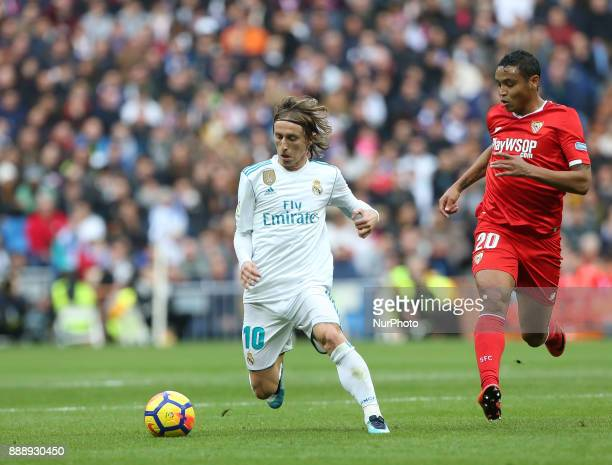 Lika Modric of Real Madrid CF is challenged by Sevilla's Colombian forward Luis Muriel during the La Liga match between Real Madrid and Sevilla at...