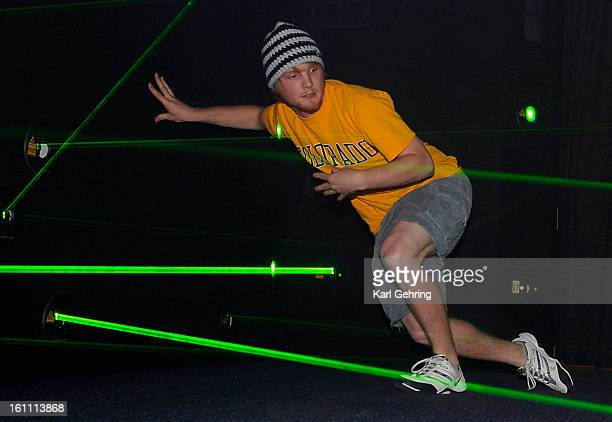 Like a Hollywood jewel thief Zach Pyle weaved between lasers in a game created by Boulder's Funovation company Funovation invited customers family...
