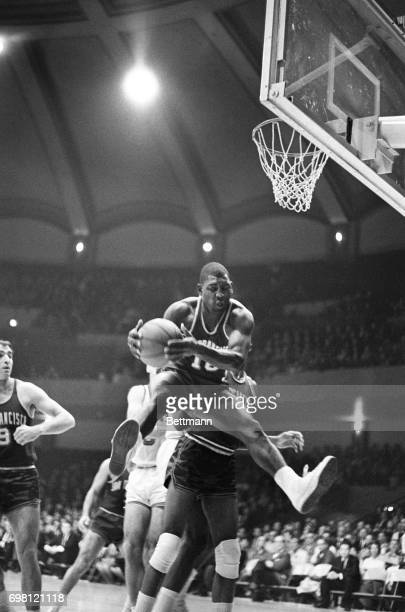 Like a jackinthebox Warriors Al Attles bounds in the air to recover a rebound in the 1st quarter of the HawksWarriors game
