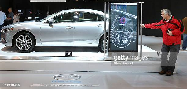 Like a xray machine a screen will show you what is in the car as you move it along the Mazda 6 at the Canadian International Auto Show at the Metro...