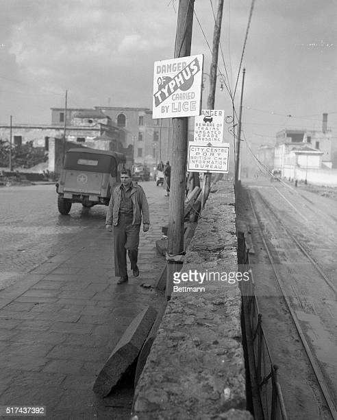 Like every other American soldier in Naples PFC Paul Zimmer of Oakland California is only too well aware of the truth of the sign over his head The...