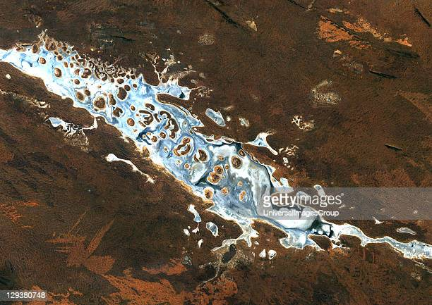 Like frantic brushstrokes fire scars cover the arid landscape near Lake Amadeus in Australia's Northern Territory Lake Amadeus is rich in salts that...