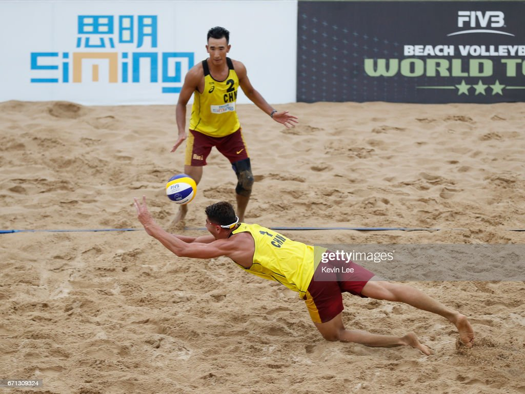 Likejiang Ha(Bottom) and Jian Bao of China in action at the FIVB Beach Volleyball World Tour Xiamen Open 2017 on April 21, 2017 in Xiamen, China.