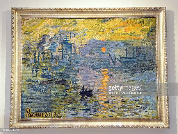 A likeness of French painter Claude Monet's 'Impression Sunrise' made of 5mmsquare bread pieces is displayed during an exhibition at a Tokyo...