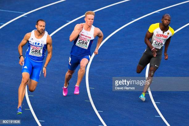 LikourgosStefanos Tsakonas of Greece Sam Miller of Great Britain Aleixo Platini Menga of Germany compete in the Men's 200m heat 1 during day 1 of the...