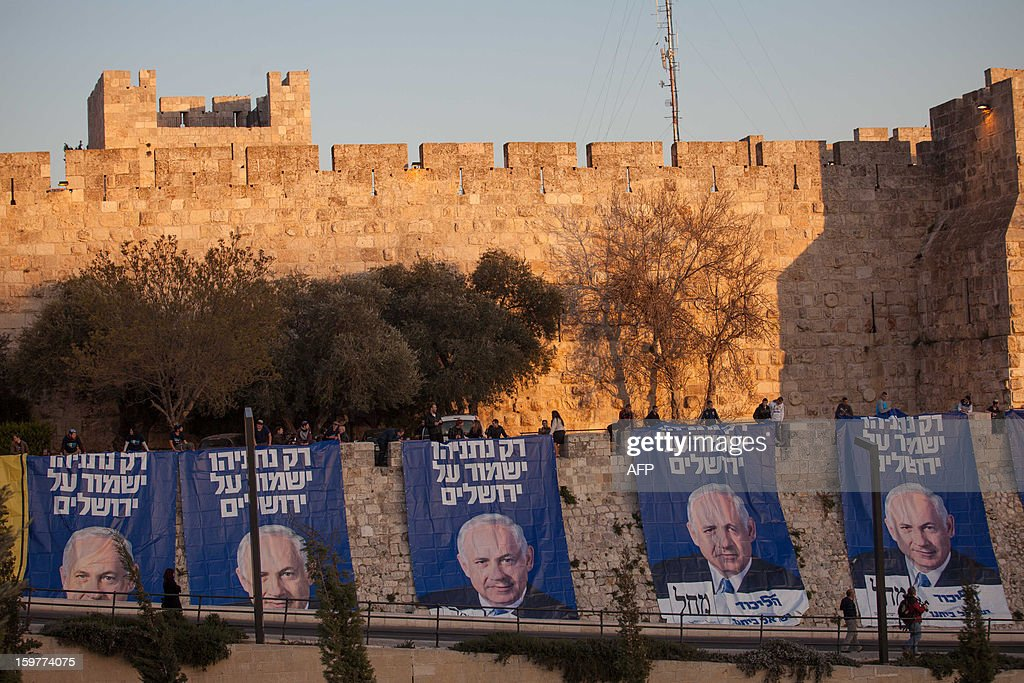 Likud party activists hang campaign posters of Israeli Prime Minister Benjamin Netanyahu that read in Hebrew ' Only Netanyahu will guard Jerusalem' under David's Citadel at Jaffa Gate in the old city of Jerusalem on January 20, 2013, ahead of the Israeli general election on January 22. == ISRAEL OUT ==