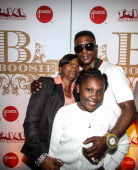 Lil Bossie poses with his mother and daughter The LIL Boosie press conference at W Hotel New Orleans on March 10 2014 in New Orleans Louisiana