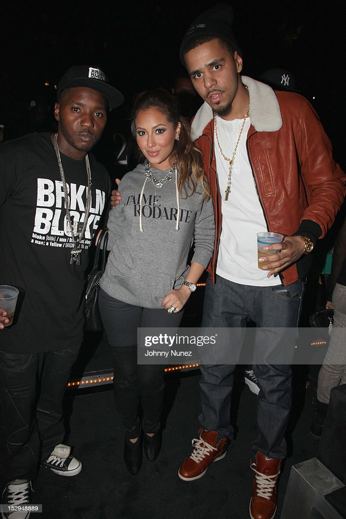 Lil' Cease, Adrienne Balon and <a gi-track='captionPersonalityLinkClicked' href=/galleries/search?phrase=J.+Cole&family=editorial&specificpeople=5958978 ng-click='$event.stopPropagation()'>J. Cole</a> backstage at the exclusive D'USSE VIP Lounge at Barclays Center on September 28, 2012 in New York City.
