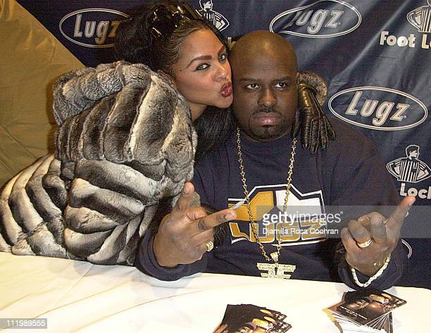 Lil' Kim and Funkmaster Flex during Funkmaster Flex Presents The New FMF1 Driving Shoe at Foot Locker in New York City New York United States