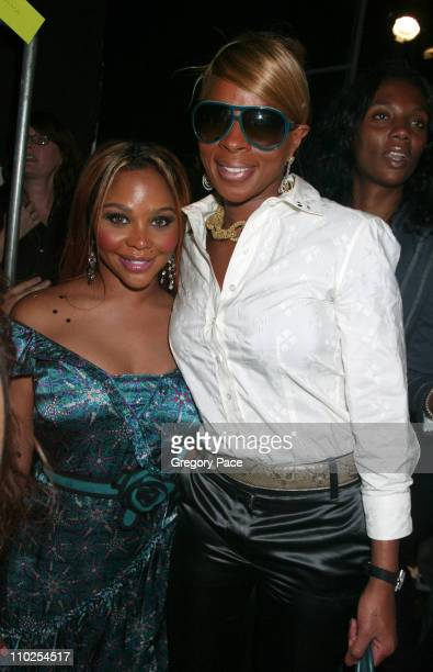 Lil Kim and Mary J Blige during Olympus Fashion Week Spring 2006 Marc Jacobs Front Row and Backstage at NY State Armory in New York City New York...