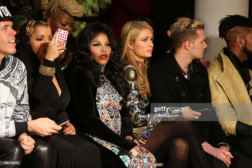 <a gi-track='captionPersonalityLinkClicked' href=/galleries/search?phrase=Lil%27+Kim&family=editorial&specificpeople=202942 ng-click='$event.stopPropagation()'>Lil' Kim</a> (L) and <a gi-track='captionPersonalityLinkClicked' href=/galleries/search?phrase=Paris+Hilton&family=editorial&specificpeople=171761 ng-click='$event.stopPropagation()'>Paris Hilton</a> attend the The Blonds fashion show during MADE Fashion Week Fall 2014 at Milk Studios on February 12, 2014 in New York City.