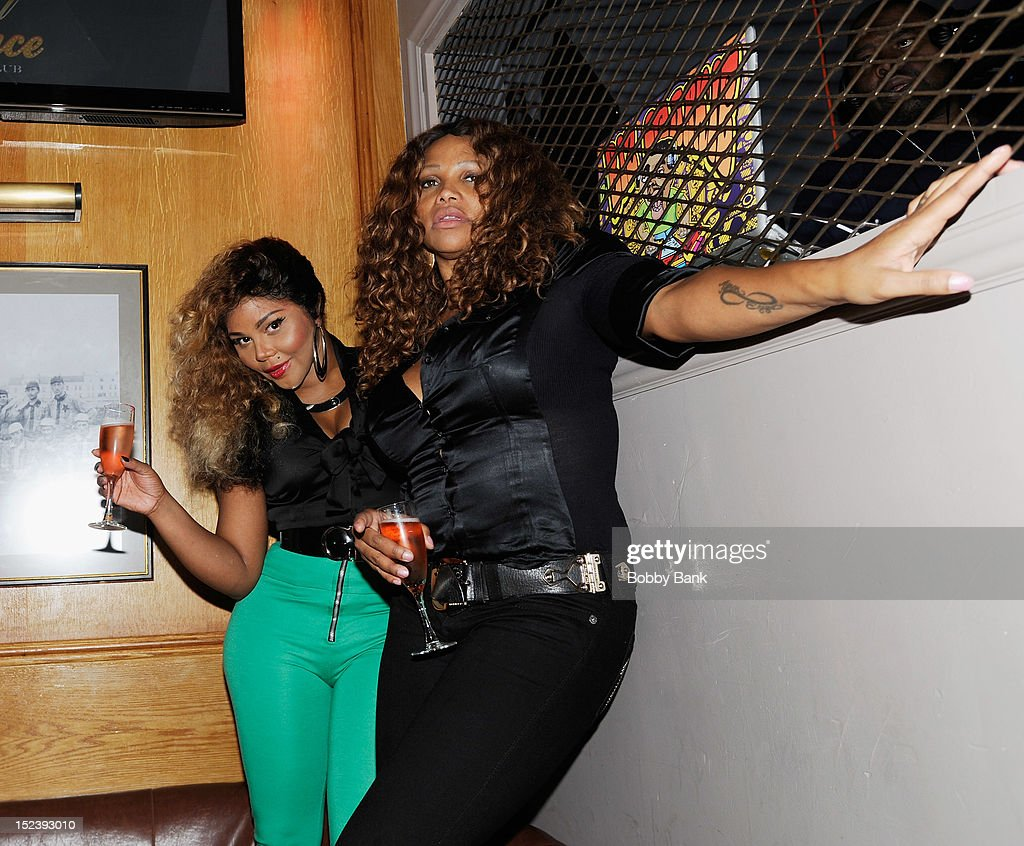 Lil Kim and Sandra 'Pepa' Denton (R) attends the 1 year anniversary party at Bounce Sporting Club on September 19, 2012 in New York City.