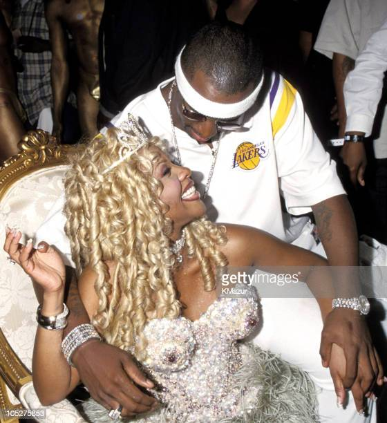 Lil Kim and Sean 'Puffy' Combs during Sean Puffy Combs Restaurant 'Justin's' Grand Opening at Justin's in New York City New York United States