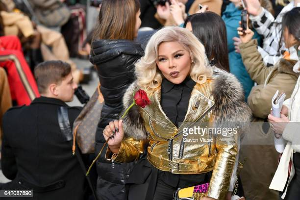Lil' Kim arrives at the runway for the Marc Jacobs Fall 2017 Show at Park Avenue Armory on February 16 2017 in New York City