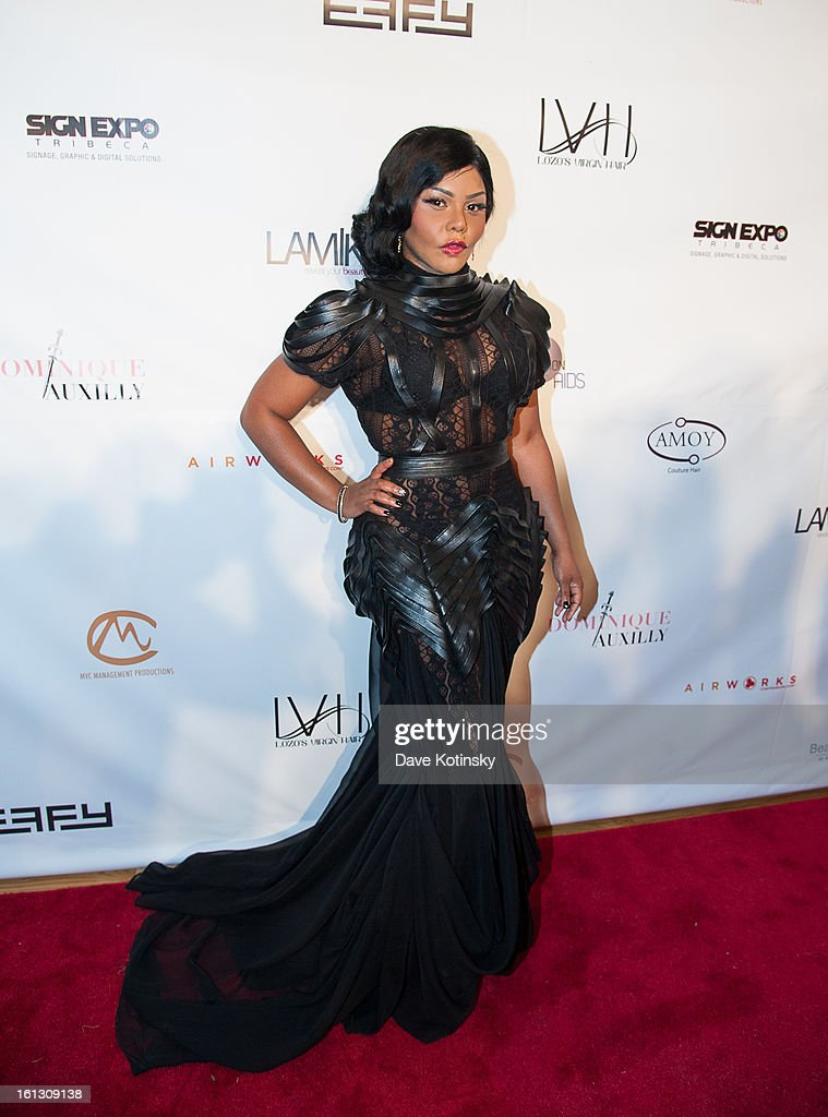 <a gi-track='captionPersonalityLinkClicked' href=/galleries/search?phrase=Lil%27+Kim&family=editorial&specificpeople=202942 ng-click='$event.stopPropagation()'>Lil' Kim</a> attends 'The Reality Of Fashion, The Reality Of AIDS' Benefit during Fall 2013 Fashion Week at Altman Building on February 9, 2013 in New York City.
