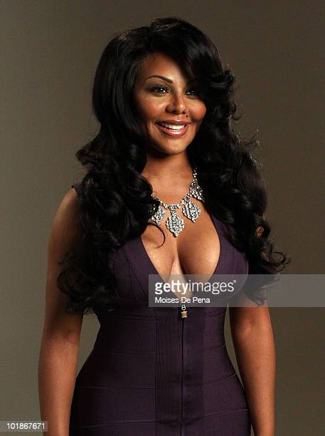 Lil Kim attends the Three Olives Vodka 'Purple' photo shoot at the DriveIn Studio on June 7 2010 in New York City