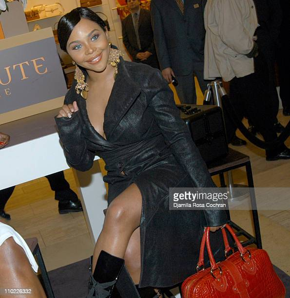 Lil' Kim during Lil'Kim attends Cassandra Mills' Haute Face Launch at Saks Fifth Avenue in New York City New York United States