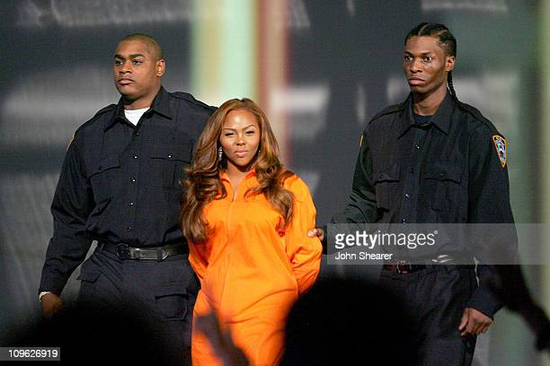 Lil' Kim is escorted out to present Best Male Video award
