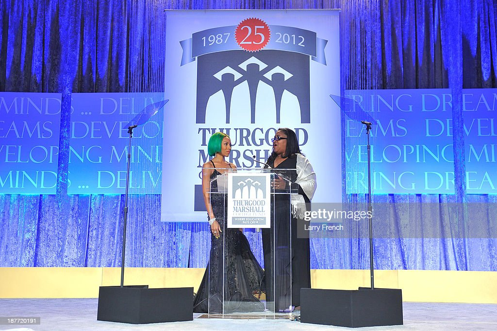 <a gi-track='captionPersonalityLinkClicked' href=/galleries/search?phrase=Lil+Mama&family=editorial&specificpeople=4231669 ng-click='$event.stopPropagation()'>Lil Mama</a> and Gigi Dixon speak onstage at the Thurgood Marshall College Fund 25th Awards Gala on November 11, 2013 in Washington City.