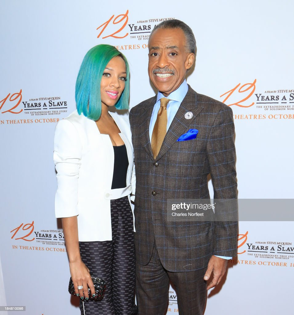 Lil' Mama and Reverend <a gi-track='captionPersonalityLinkClicked' href=/galleries/search?phrase=Al+Sharpton&family=editorial&specificpeople=202250 ng-click='$event.stopPropagation()'>Al Sharpton</a> attend the '12 Years A Slave' screening at AMC Empire 25 theater on October 16, 2013 in New York City.