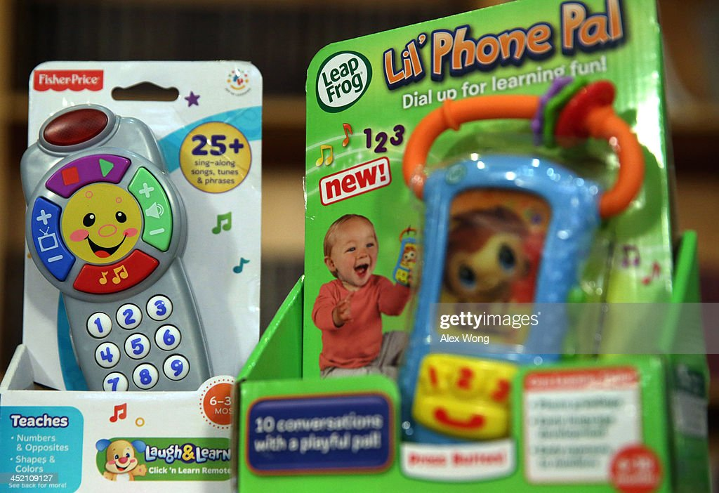 A Lil' Pal Phone toy (R) and a Fisher Price Laugh & Learn Remote toy, examples of potential noise hazards, are seen during a news conference on dangerous toys November 26, 2013 in Washington, DC. United States Public Interest Research Group (U.S. PIRG) released its 28th annual Trouble in Toyland report and list of dangerous toys to avoid this holiday season.