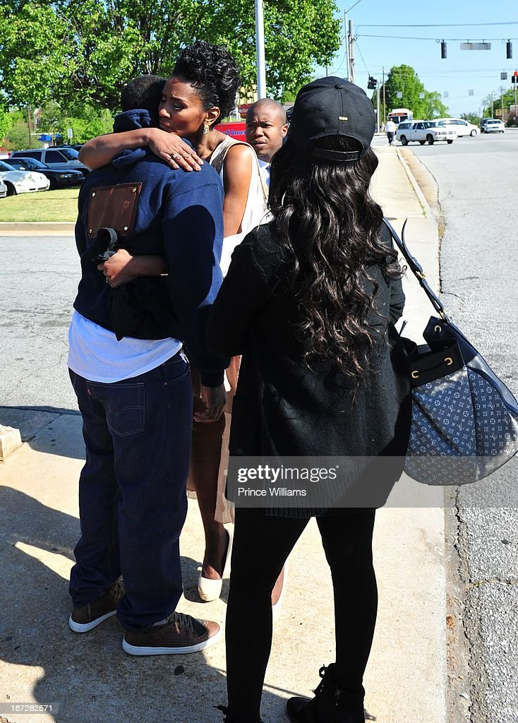 <a gi-track='captionPersonalityLinkClicked' href=/galleries/search?phrase=Lil+Scrappy&family=editorial&specificpeople=775495 ng-click='$event.stopPropagation()'>Lil Scrappy</a>, Mama Dee and Erica Dixon <a gi-track='captionPersonalityLinkClicked' href=/galleries/search?phrase=Lil+Scrappy&family=editorial&specificpeople=775495 ng-click='$event.stopPropagation()'>Lil Scrappy</a> Turns Himself In at Atlanta Police Department on April 23, 2013 in Atlanta, Georgia.