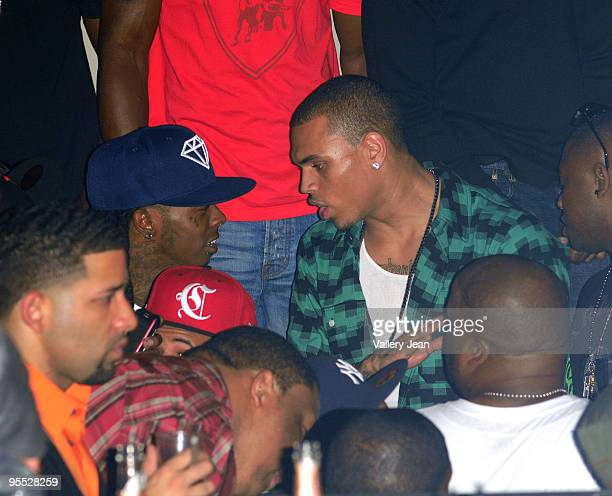 Lil Wayne and Chris Brown attend a party presented by Bartley International in association with the 400 Club at Play Nightclub on January 1 2010 in...
