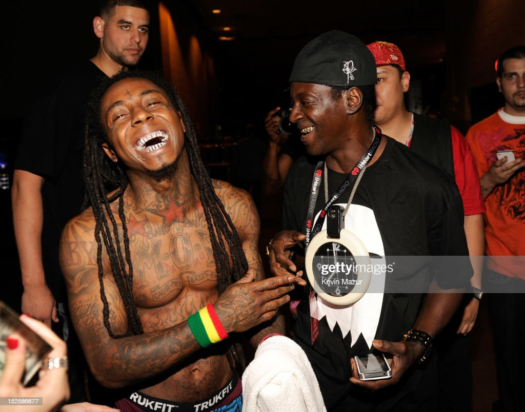 Lil Wayne and <a gi-track='captionPersonalityLinkClicked' href=/galleries/search?phrase=Flavor+Flav&family=editorial&specificpeople=171122 ng-click='$event.stopPropagation()'>Flavor Flav</a> backstage during the 2012 iHeartRadio Music Festival at MGM Grand Garden Arena on September 21, 2012 in Las Vegas, Nevada.