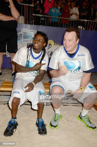 Lil Wayne and Tom Arnold attend DIRECTV'S 7th Annual Celebrity Beach Bowl at DTV SuperFan Stadium at Mardi Gras World on February 2 2013 in New...