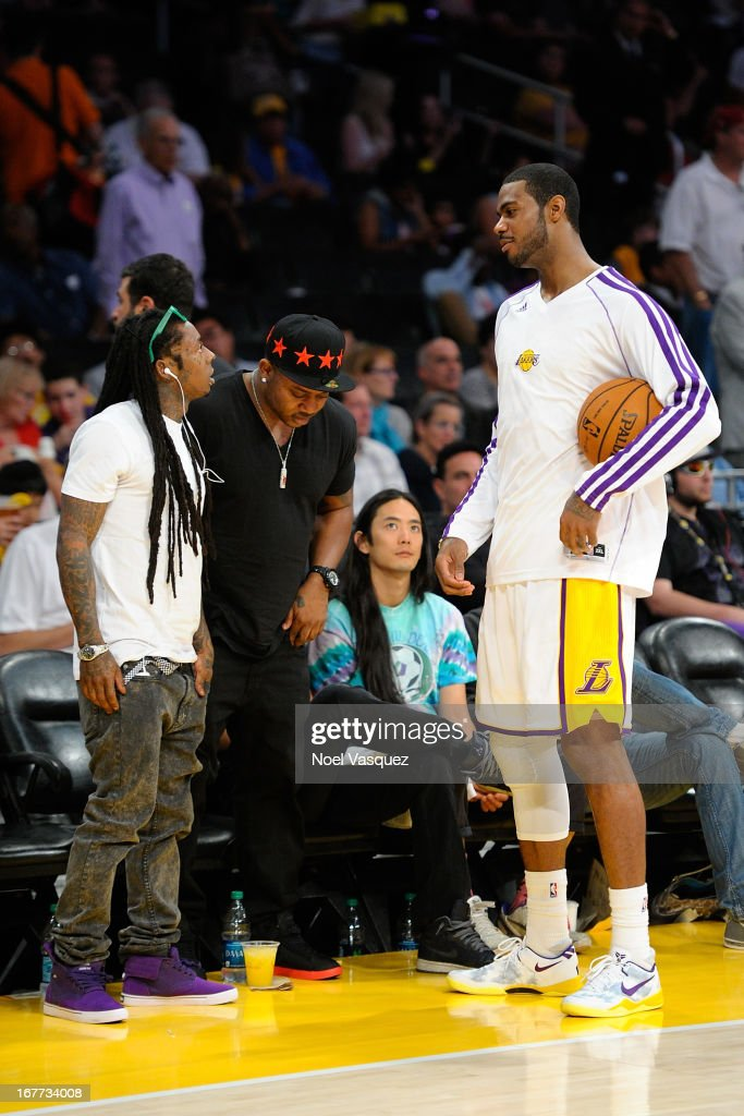 Lil Wayne attends an NBA playoff game between the San Antonio Spurs and the Los Angeles Lakers at Staples Center on April 28, 2013 in Los Angeles, California.