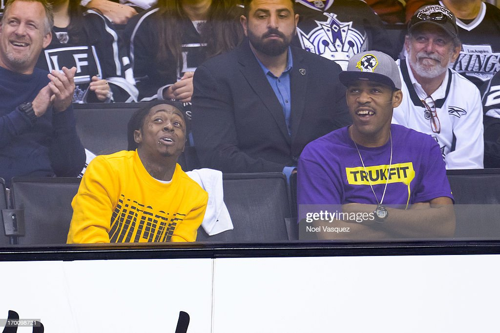 Lil Wayne (L) attends an NHL playoff game between the Chicago Blackhawks and the Los Angeles Kings at Staples Center on June 6, 2013 in Los Angeles, California.