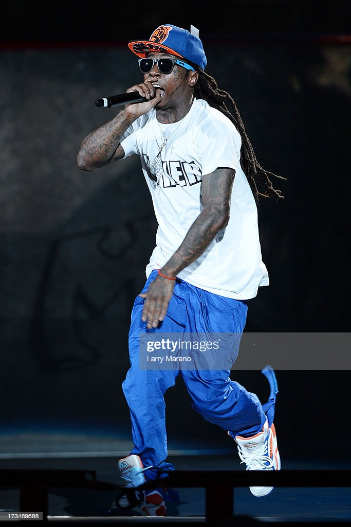 Lil Wayne performs at Cruzan Amphitheatre on July 14, 2013 in West Palm Beach, Florida.