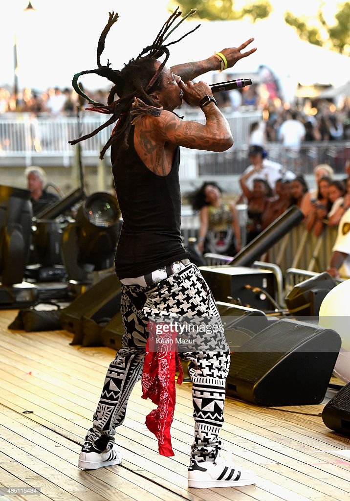 Lil Wayne performs during Billboard Hot 100 Festival Day 1 at Nikon at Jones Beach Theater on August 22 2015 in Wantagh New York