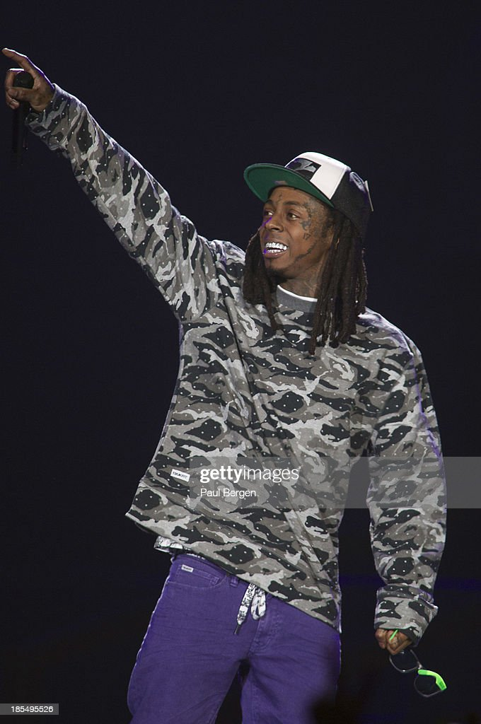 Lil' Wayne performs on stage at Ziggo Dome on October 21, 2013 in Amsterdam, Netherlands.